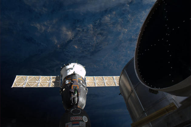 Soyouz docked with the ISS in Space by Andre Kuipers