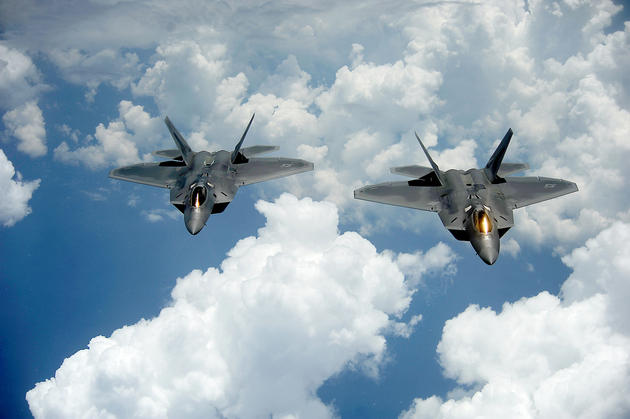 A Pair of F22s flying in formation