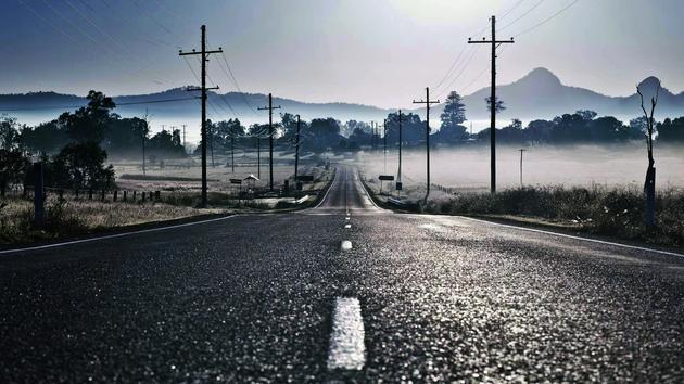 A foggy road in the morning HD Wallpaper
