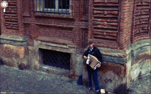 Musician on the corner playing Google Maps