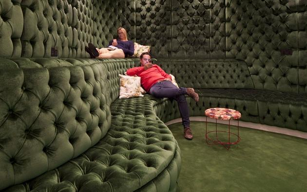 Authentic dark green padded room like a pub