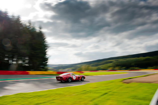 Ferrari GTB Going Fast on Racetrack