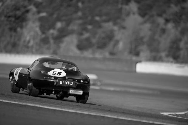 Black Jaguar E-type flying down the track