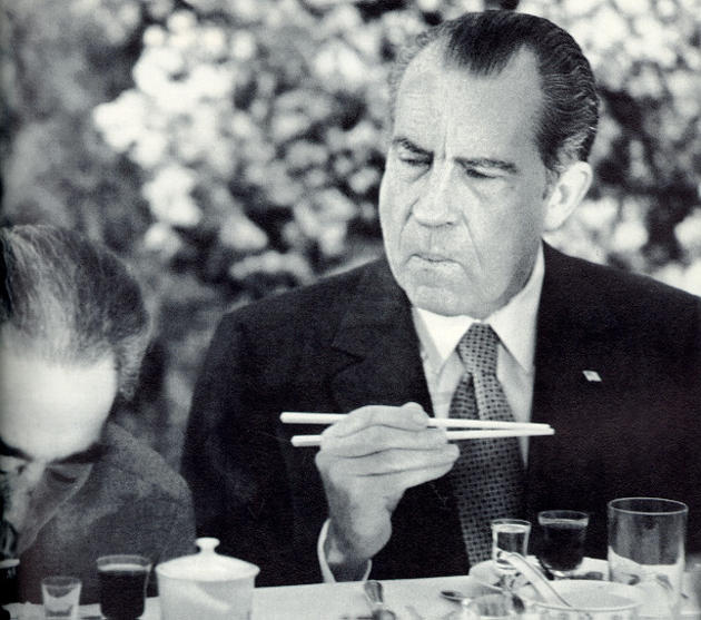 Nixon learning how to use chopsticks in China