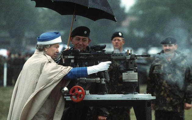 Queen Elizabeth firing the Enfield battle rifle