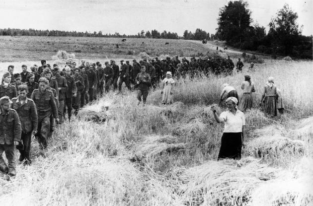 German POWs marching east. 1944 Note the woman showing a fist