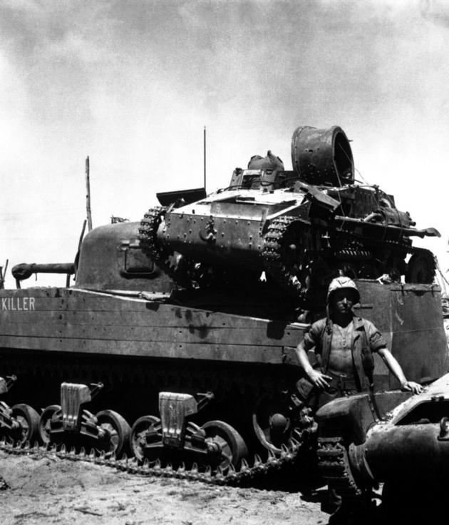 An American M4 tank carrying a small type 94 Japanese tank