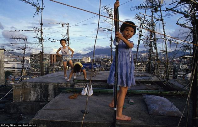 Kids playing on the roof tops of Kowloon.
