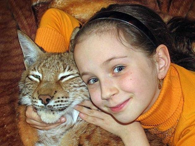 Girl and her lynx are best friends