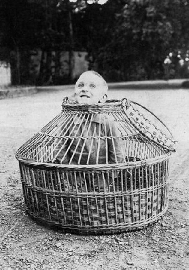 Old Weird Photos kid in cage