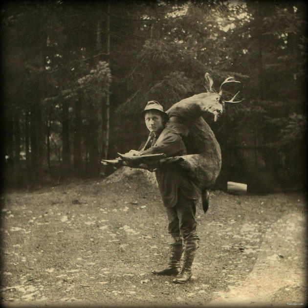 Old Weird Photos carrying a deer