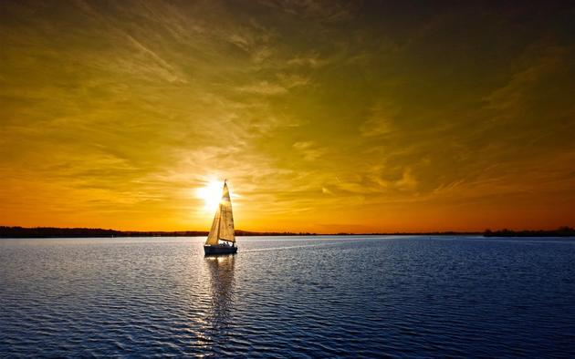A sunset over a sail boat HD Wallpaper