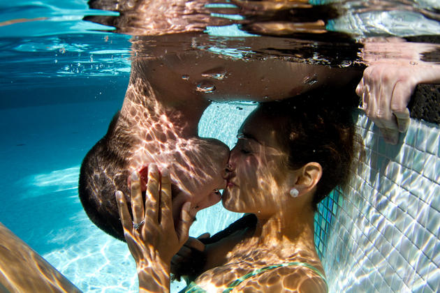Underwater couple kissing Sarah Lee