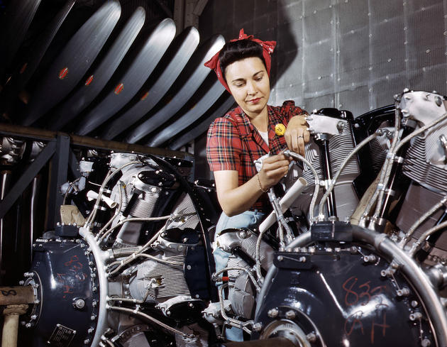 An engine inspector checks over B-25 engines