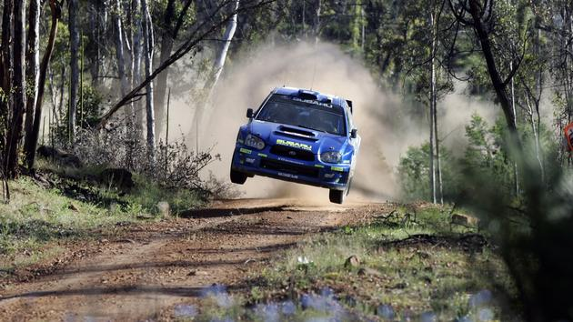 Subaru STi catching air Rally Wallpaper