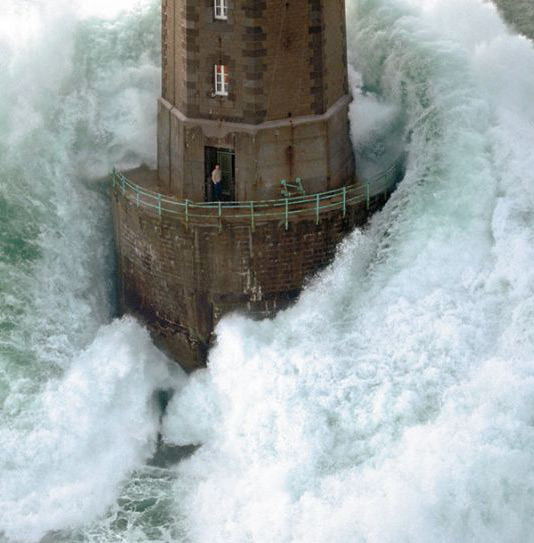 A Man Caught Outside Of A Lighthouse During A Huge Storm